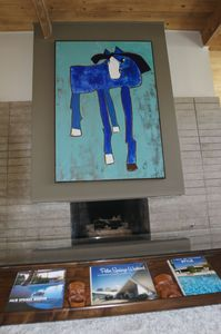 Rendevous Lou namesake is our blue horse painting. Lots of books on Palm Springs