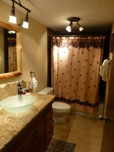 Recently remodeled bathroom with granite counter top
