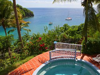 Marigot Bay apartment photo - View over the pool and horizon