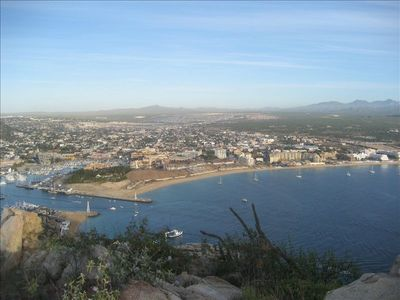 view of Cabo from hill at left end of beach