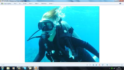 Scuba diving at our recommended dive school.