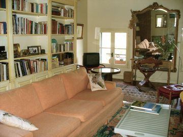 Part of livingroom with windows to the Place aux Herbes