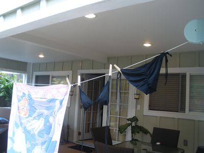 Retractable clothes line is handy after the beach!