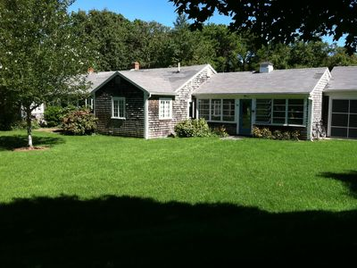 Three bedroom-plus house on 6.5 secluded acres near bay beaches.
