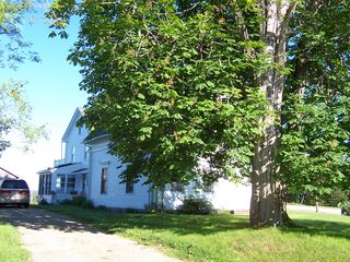 Deer Isle house photo - This view of the house is from the street with large yard to the left.