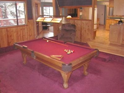 Large billiard room opens into kitchen, living room, and large redwood decks.
