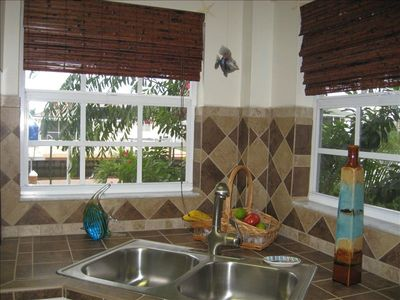 The full kitchen provides a sunny view and all the comforts of home.