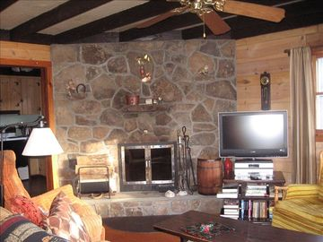 Living room with cozy woodburning fireplace. Unlimited wood provided! 2011