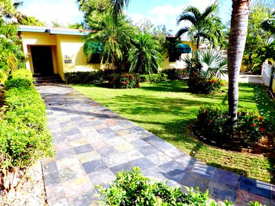 Casa Koyari's front walkway surrounded by lush tropical gardens