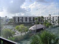 Condo in Waterfront Resort with views of the pool !  Close to shopping and Restaurants Tidy and comfy vacation condo