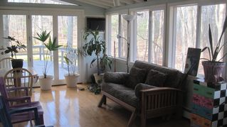 East Greenwich house photo - Four season sun room facing the backyard..deer, grouse, owls, wood-peckers.