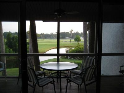 Screened porch off living room overlooking lagoon, first tee