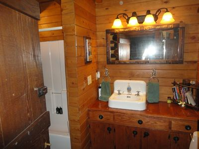 The Bear Cabin bathroom with tub and shower. The hot tub is off this bathroom.