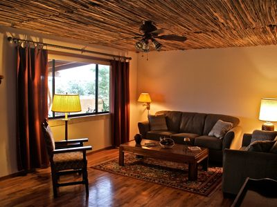 Saguaro Rib Ceiling and Hardwood floors enhance the view from the picture window
