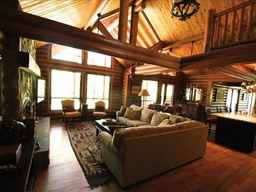 Happy Jack cabin rental - living room w/vaulted ceilings, sectional sofa, flat-screen TV, and fireplace
