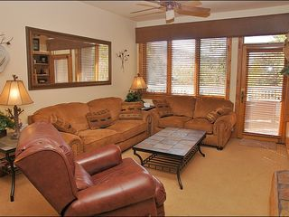Steamboat Springs condo photo - Comfortable, Stylish Living Room with Fireplace, TV, DVD, & Stereo.