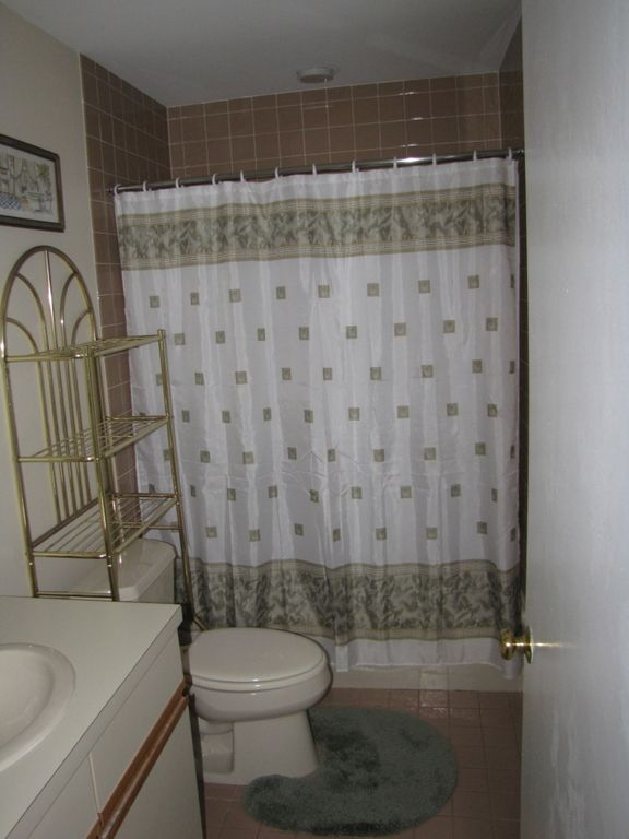 Private bathroom in master bedroom includes a tub.