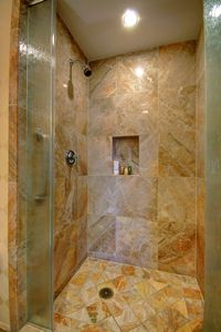 Full guest bathroom with shower opens from the living room.