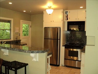 Fully stocked gourmet kitchen with an eat-in dining area.