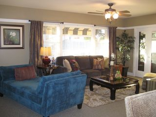 Long Beach apartment photo - Living room with a queen size sleeper. Walk-in closet behind mirrored doors.