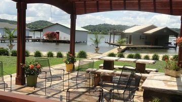 Guntersville Lake house rental - GREAT AREA TO VIST WITH BUILT IN BENCHES, PICNIC TABLE AND FISH TABLE.