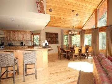 Tahoe Donner house rental - View of kitchen, breakfast bar, dining rm and glass wall into forest