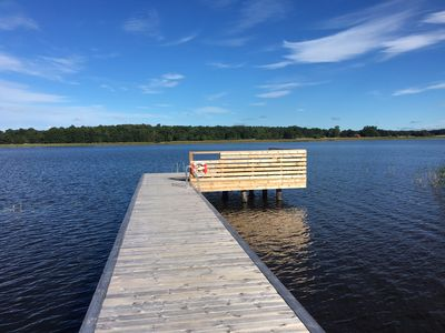 Cottage by the lake with private dock, large garden with barbecue area and sauna.