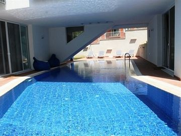 Private pool with sunbeds and sitting corner