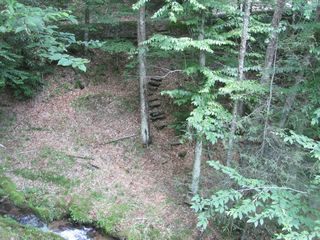 Maggie Valley cabin photo - View from cabin deck showing steps to walk down to the creek