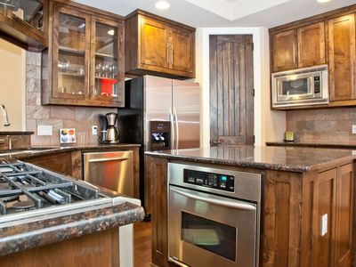 Clean and spacious kitchen with stainless steel appliances