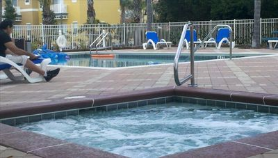 Emerald Island condo rental - 1 Minute walk to pool and hot tub. Also bathrooms are located here.