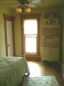 2nd flr Twin bedroom has dresser, closet and door to balcony.