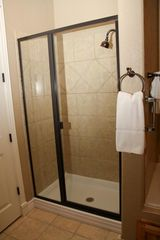 Branson condo photo - Walk In Tile Showers - Bronze Fixtures