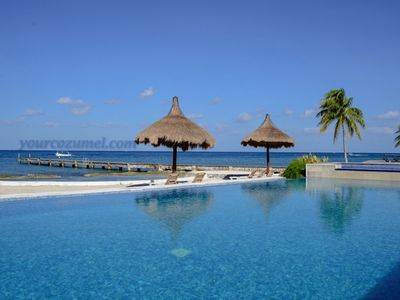 Guests enjoy the pool, beach, and private pier