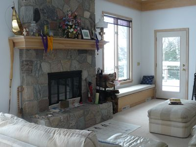 Great room and split stone fireplace.