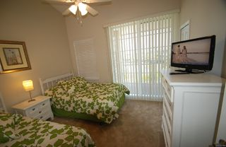 Tampa townhome photo - Bedroom 2. 1 full bed and 1 twin size bed balcony w.partial water & street view