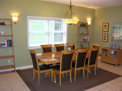 Large dining area with seating for 8. Part of open concept with kitchen and LR.