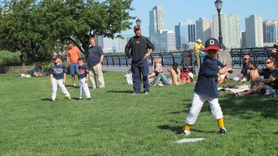 Fun in the neighborhood - my son's little league team in the park downstairs