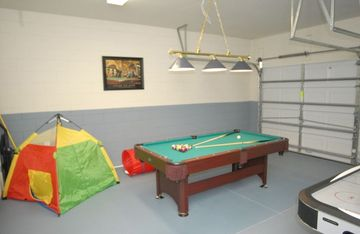 Gameroom with basketball chute, pool table, little ones play area, air hockey
