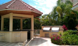 Vanderbilt Beach condo photo - Poolside grills, bar and dining area available for use by renters