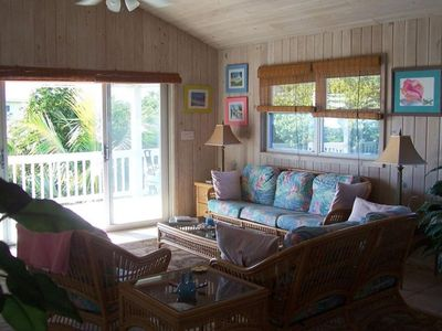 Cottage Livingroom Area with 12 foot sliding door and Sea of Abaco view.