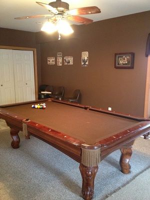 Full size pool table in downstairs living area.