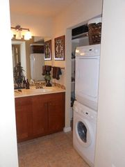 Austin condo photo - Bathroom vanity area w/ washer/ dryer. Detergent provided. Iron and iron board.
