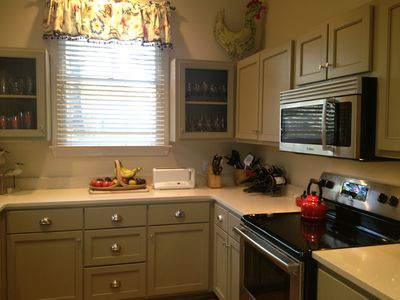 Newly renovated kitchen with stainless steel appliances and quartz countertop!
