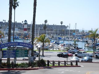 Oceanside condo photo - That's us just beyond the harbor. Walk to harbor shops & restaurants!
