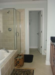 Master Bath w/ jacuzzi tub, separate tile shower, dual sinks, & walk-in closet