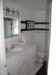Southold house photo - First full bathroom with tub and shower