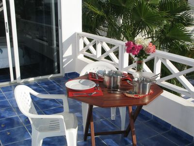 Romantic dinner overlooking the azure ocean from your own private balcony?