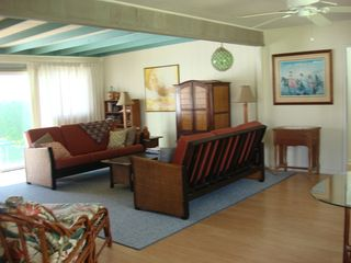 Kailua house photo - Spacious open air living room with TV/DVD player magazines and games.