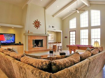 Vast Living Room with Fireplace, Audio/Video Surround Sound and Billiard Areas.